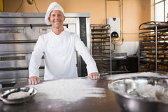 Smiling baker standing behind the counter Stock Images