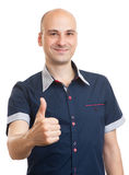 Smiling bald guy showing thumbs up Royalty Free Stock Photos