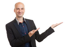 Smiling bald man presenting your text or product Royalty Free Stock Photos