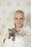 Smiling bald woman with cat Royalty Free Stock Images