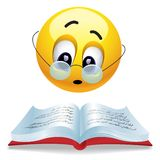 Smiling ball. Reading book with glasses Royalty Free Stock Image