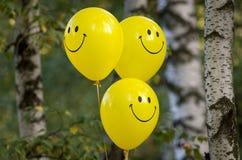 Smiling ballons. Yellow smiling ballons Royalty Free Stock Image