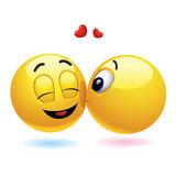 Smiling balls. Smiling ball kissing another who is surprised Royalty Free Stock Image