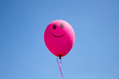 Smiling baloon. Smiley balloon against the blue sky Royalty Free Stock Photography