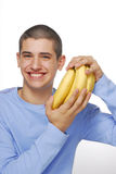 Smiling with bananas Royalty Free Stock Photo