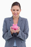 Smiling bank clerk with piggy bank Royalty Free Stock Photo