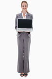 Smiling bank employee presenting her laptop Royalty Free Stock Image