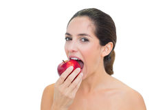 Smiling bare brunette eating red apple Royalty Free Stock Photo