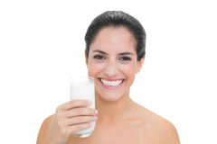 Smiling bare brunette holding glass of milk Royalty Free Stock Photography