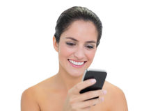 Smiling bare brunette using smartphone Stock Photos