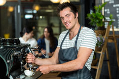 Smiling barista making coffee. In the bar Stock Image