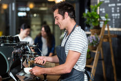 Smiling barista making coffee. In the bar Stock Photography