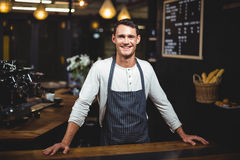 Smiling barista standing in the bar. And looking at the camera Stock Photography