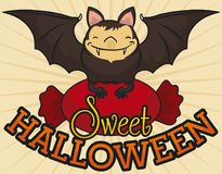 Smiling Bat Holding a Wrapped Hard Candy Celebrating Halloween, Vector Illustration Royalty Free Stock Photo