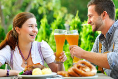 Smiling bavarian couple at Oktoberfest Stock Images