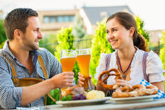 Smiling bavarian couple at Oktoberfest royalty free stock photos
