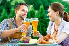 Smiling bavarian couple at Oktoberfest stock photography