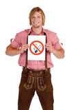Smiling Bavarian man holds non-smoking-rule sign Royalty Free Stock Images