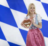 Smiling bavarian woman with Oktoberfest heart Royalty Free Stock Photography