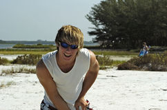 Smiling beach boy. A young smiling muscular male teenager enjoyed the sun in florida Stock Image