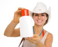 Smiling beach young woman showing sun block creme Royalty Free Stock Image