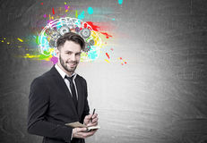 Smiling bearded businessman, brain and cogs Stock Image