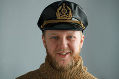 Smiling, bearded captain. In a brown sweater Royalty Free Stock Photos
