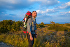 Smiling bearded hiker on the sea coast. Enjoying life at sunny evening, Cyprus Royalty Free Stock Photos