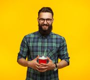 Cheerful bearded man with plastic cup royalty free stock images