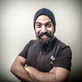 Smiling bearded man. With cap  on gray background Stock Image
