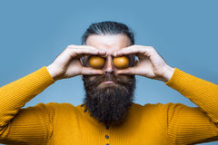 Smiling bearded man with egg Royalty Free Stock Photography