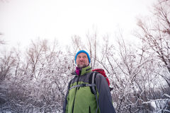 Smiling bearded man hiker relaxing at the winter holidays Stock Photography
