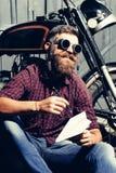 Smiling bearded man hipster biker Stock Photos