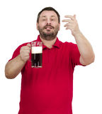 Bearded chap inviting to pub. Smiling bearded chap in red polo shirt inviting to pub Royalty Free Stock Photo