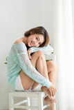 Smiling beautiful asian woman relaxing in the morning sitting in. Doors Stock Photos