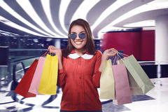 Smiling beautiful asian woman with shopping bags Royalty Free Stock Images