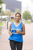 Smiling beautiful athletic woma running in the street. Royalty Free Stock Image