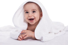 Smiling beautiful baby child with white towel Royalty Free Stock Photos