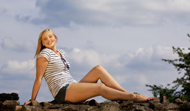 Smiling beautiful blond teenage girl Stock Photography