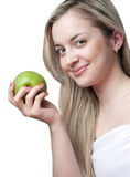 Smiling  beautiful blond  woman with apple Royalty Free Stock Images