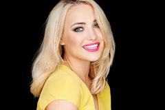 Smiling beautiful blond woman wearing makeup stock photos