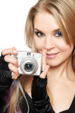 Smiling beautiful blonde holding a photo camera Stock Photos