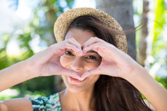 Smiling beautiful brunette doing heart shape with her hands Royalty Free Stock Photo