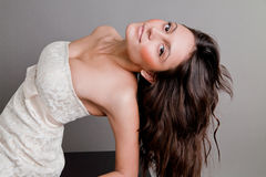 Smiling beautiful brunette in a dress Royalty Free Stock Photo