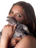 Smiling beautiful brunette holding and petting her bunny Stock Photos