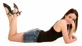 Smiling Beautiful Brunette Lying Down and Relaxing Stock Images