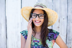Smiling beautiful brunette speaking on the phone Royalty Free Stock Photos