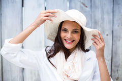 Smiling beautiful brunette wearing straw hat and looking at camera Stock Photos