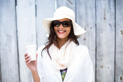 Smiling beautiful brunette wearing straw hat and sun glasses Stock Image