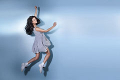 Smiling beautiful brunette woman jumping. Stock Photos